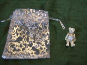 Wedding favour. pewter jointed bear pin
